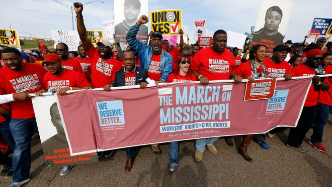 Thousands march to Nissan Motor Co.'s Canton, Miss., plant, following a pro-union rally on March 4, 2017.