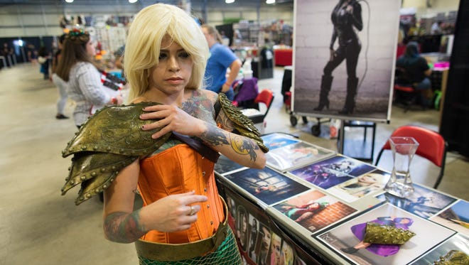 Cosplayer Rozlin Gomez known as Rozzmonster puts on her Aquaman armer before the start of the Corpus Christi Comic Con at the Richard M. Borchard Regional Fairgrounds in Robstown on Saturday, July 22, 2017.