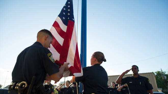 Corpus Christi Police Academy cadets raise the flag during their morning formation on Thursday, July 27, 2017.