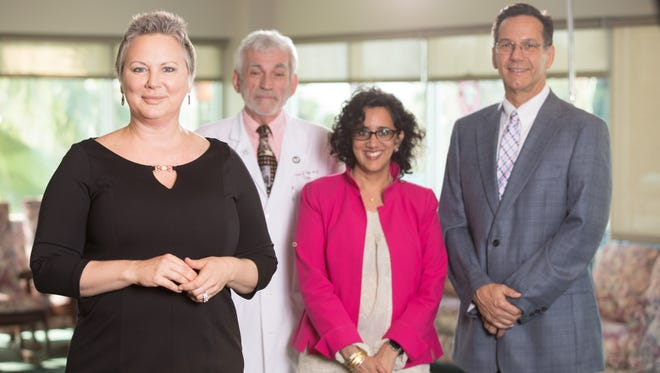 Diana Pratt, front, credits her Stuart-based oncology team with helping her stay close to home while fighting a highly aggressive form of breast cancer. Her team included, back row, from left, James Vopal, MD, breast surgeon; Alpana Desai, MD, medical oncologist; and Michael Burke, MD, Martin Health Physician Group radiation oncologist.