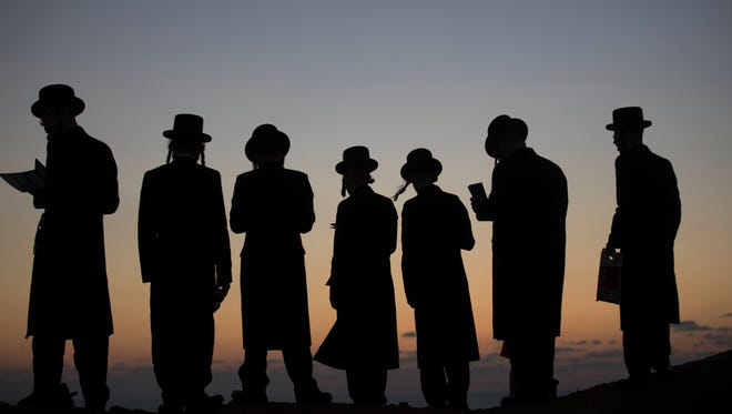 Ultra-Orthodox Jews perform a Jewish prayer named Tashlich a day ahead of Yom Kippur, on a hill overlooking the Mediterranean Sea, next to the Israeli city of Herzeliya, Israel.