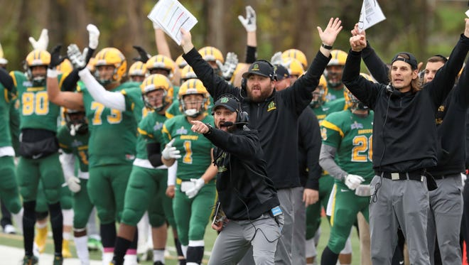 Jason Mangone, 40, has been with the SUNY Brockport football program for 21 seasons, the last five as head coach. He has returned to the Golden Eagles to national prominence with a 10-0 record and Top 10 ranking.
