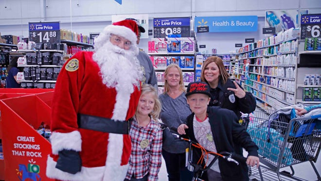Shoppers enjoy Christmas with a Cop on Saturday in Clarksville.