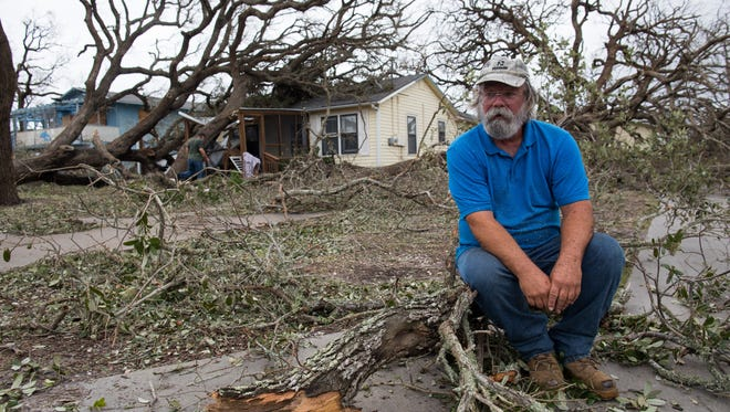 David Graves takes a break from clearing trees to his home along Palm Street in Fulton Texas a day after Hurricane Harvey made land fall. (Sunday, Aug. 27, 2017)