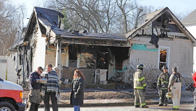 Clarksville Police officers rescue a man from a burning home on Stafford Street early Saturday morning.