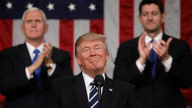 In this Feb. 2017, file photo, President Trump addresses a joint session of Congress on Capitol Hill in Washington, as Vice President Mike Pence and House Speaker Paul Ryan of Wis., applaud. President Trump' will deliver his first state of the union speech Tuesday.