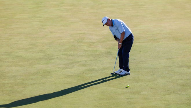 Shadows get longer as Joe Durant hits his second to the last putt for the day on the 18th green at the Chubb Classic at the Twin Eagles golf course in Naples, Fla. on Saturday, February 17, 2018.
