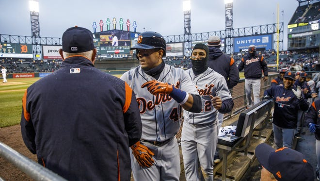 The Detroit Tigers' Victor Martinez (41) returns to the dugout after hitting an RBI double during the ninth inning against the Chicago White Sox at Guaranteed Rate Field in Chicago Thursday, April, 5 2018. The Tigers won, 9-7, in 10 innings.