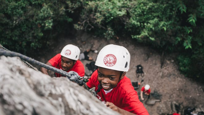 Campers learn to rock climb at Camp Grier. The camp's Streets to Peaks program connects children to outdoor adventures.
