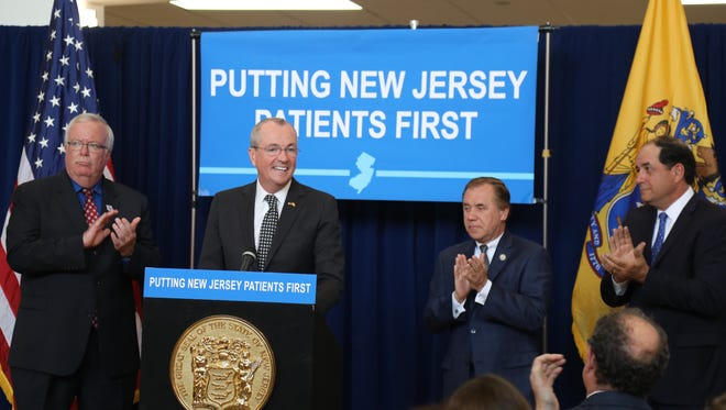 Governor Phil Murphy addresses the audience of supporters for the bill to prevent surprise medical bills for out-of-network consumers. The Governor is flanked by Woodbridge Mayor John McCormac, Assembly Speaker Craig Coughlin and Senator Joseph Vitale.