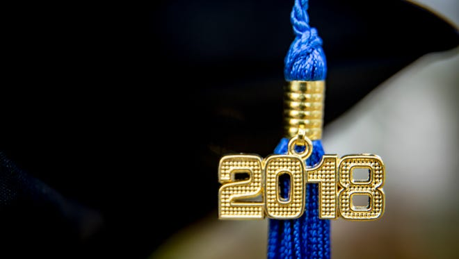 A blue 2018 Tassel on a mortarboard hat representing the class of 2018