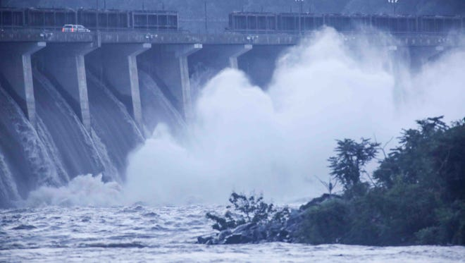 Flood gate were open as hundreds of gallons of Susquehanna river water rushes out Thursday, July. 26, 2018, at Conowingo Dam and Recreation in Darlington, MD.