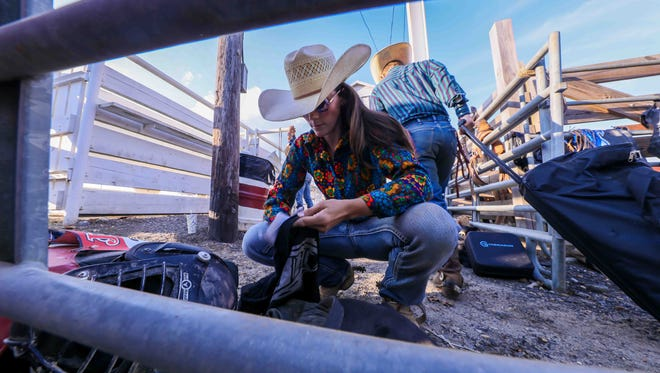 Lauren Ehrlich, of Wilmington, prepares for a bull riding competition in late July at the Cowtown Rodeo in Pilesgrove, New Jersey.
