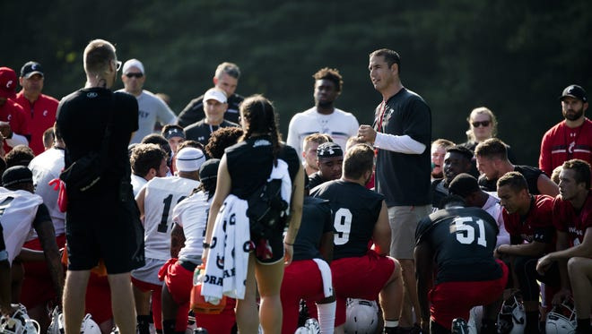 Cincinnati Bearcats head coach Luke Fickell speaks to his football team after a recent practice at Camp Higher Ground in West Harrison, Indiana.