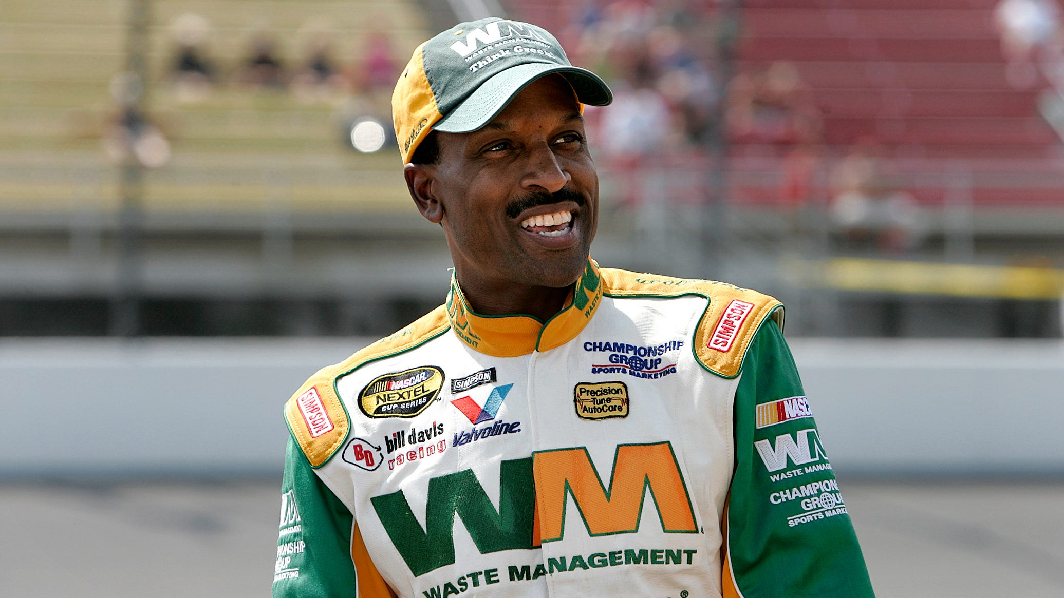Retired black NASCAR driver Bill Lester remembers being booed