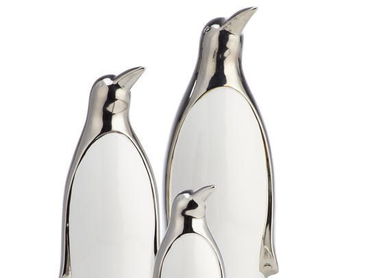 Silver-plated ceramic penguins add a dash of chic swagger