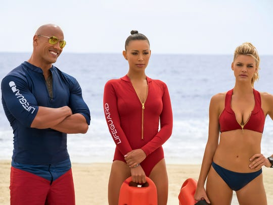 Dwayne Johnson as Mitch Buchannon, from left, Ilfenesh