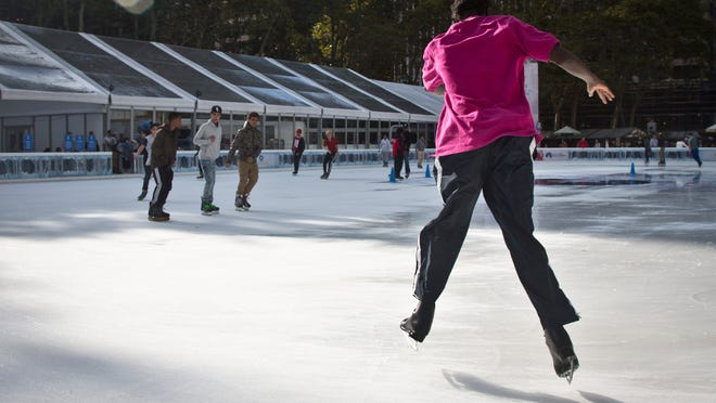 "Linval Forrest skates during the opening day at Bryant Park skating rink, Tuesday, in New York. Forrest was a track and field athlete in Jamaica before moving to Bronx, N.Y. The U.S. is experiencing a ""great wave"" of immigration, experts say."
