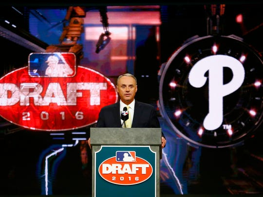 Baseball Commissioner Rob Manfred announces the No. 1 pick by the Philadelphia Phillies during the draft, Thursday in Secaucus, N.J. The Phillies selected outfielder Mickey Moniak, of La Costa Canyon High School in Carlsbad, Calif.