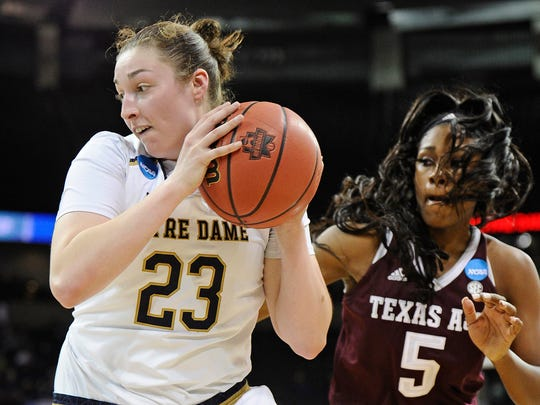 Notre Dame Fighting Irish forward Jessica Shepard (23) grabs the inbounds pass against Texas A&M Aggies forward Anriel Howard (5) in the semifinals of the Spokane regional of the women's basketball 2018 NCAA Tournament at Spokane Veterans Memorial Arena.