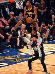 Indiana Pacers forward Glenn Robinson III (40) competes in the slam dunk contest during NBA All-Star Saturday Night at Smoothie King Center.