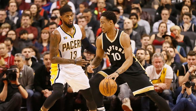 Mar 31, 2017; Toronto, Ontario, CAN; Toronto Raptors guard DeMar DeRozan (10) drives to the basket against Indiana Pacers forward Paul George (13) during the first half at the Air Canada Centre. Mandatory Credit: John E. Sokolowski-USA TODAY Sports