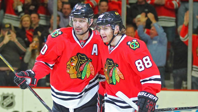 Chicago Blackhawks right wing Patrick Kane (88) congratulates left wing Patrick Sharp (10) for his third-period goal in clinching Game 6.