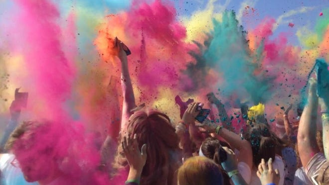 Color Run twists and turns in downtown Rochester, leaving behind a large dash of color.