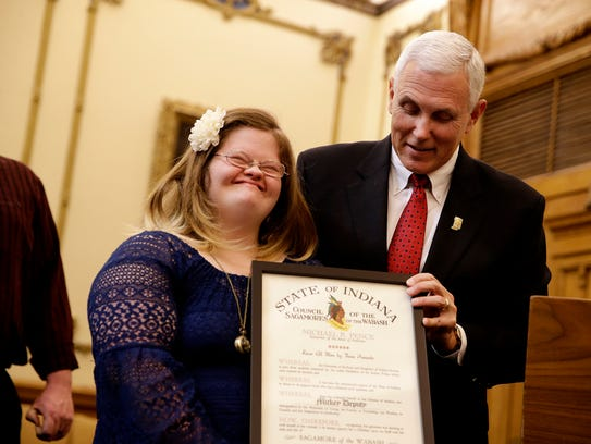 Gov. Mike Pence presents Mickey Deputy with the Sagamore