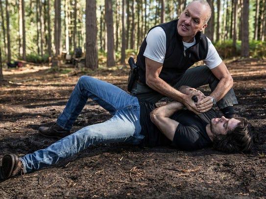 Black Ops trainer Stan Hurley (Michael Keaton) shows