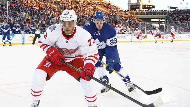 Andreas Athanasiou of the Detroit Red Wings skates against the Toronto Maple Leafs Sunday.