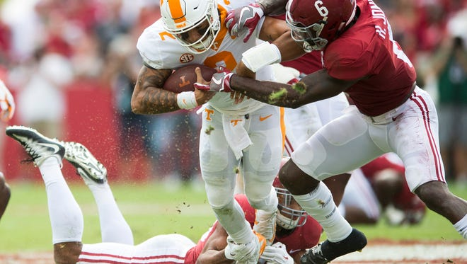 Tennessee quarterback Jarrett Guarantano (2) is tackled by a group of Alabama defenders during Tennessee's game against Alabama at Bryant Denny Stadium in Tuscaloosa on Saturday, Oct. 21, 2017.