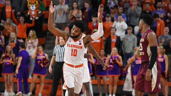 Clemson guard Gabe DeVoe (10) acknowledges the Clemson fans as he leaves the court late in the Tigers 76-63 win over Florida State on Wednesday, February 28,  2018 at Clemson's Littlejohn Coliseum.