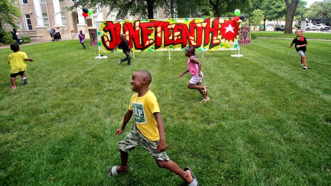 Kids have fun running around the courtsquare at a Juneteenth celebration on Friday.