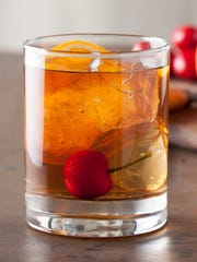 Classic old-fashioned cocktail on a wooden table