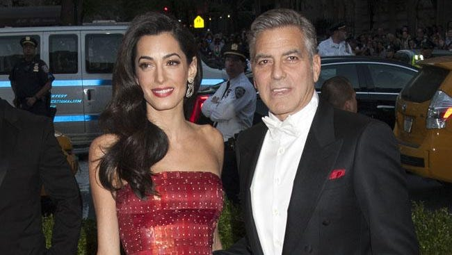 George Clooney with Amal.