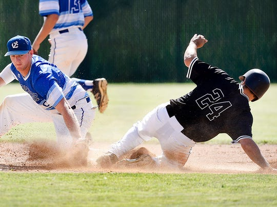 Cold Spring's Kevin Wenner safely steals second under the tab by Pelican Rapids Adam Johnson during the sixth inning in the state amateur baseball tournament  Sunday, Aug. 21, 2016, in Brownton.