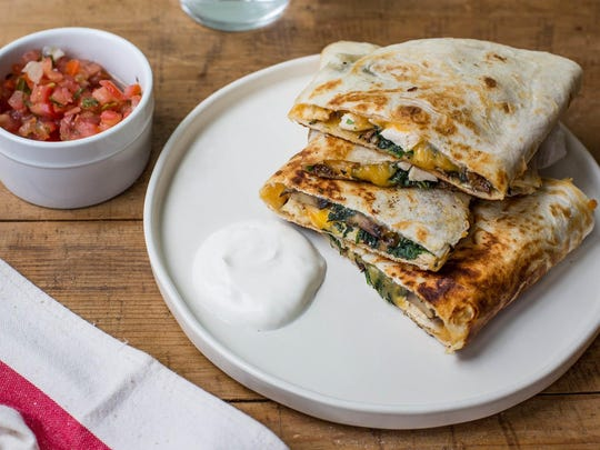 These quesadillas use spinach, mushroom and chicken, but feel free to use your own combination of ingredients.