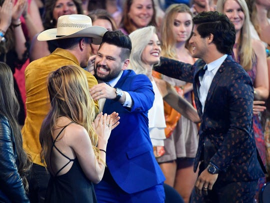 Dan and Shay are congratulated after being announced