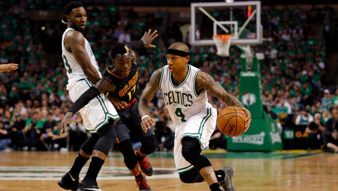 Boston Celtics guard Isaiah Thomas (4) drives the ball past Atlanta Hawks guard Dennis Schroder (17) in Game 3.