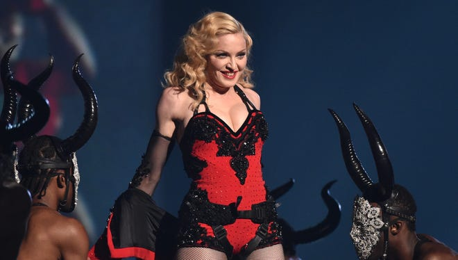 Madonna performing at the 57th annual Grammy Awards in Los Angeles on Feb. 8, 2015. The pop icon said in an interview Thursday, March 5, that being active saved her from serious injuries at the Brit Awards.