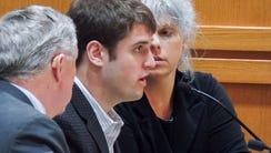 Alec Cook, center, enters guilty pleas to five felonies