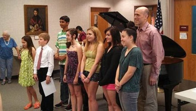 The winners of the seventh annual Hunterdon County Young Composers Contest are Steven Slack, a senior at North Hunterdon High School in Clinton Township; Conor Allan, an eighth grader at J.P. Case Middle School in Flemington, and Pranav Shankar, a third grader at Princeton Child Development Institute. Pictured are the 2014 winners.