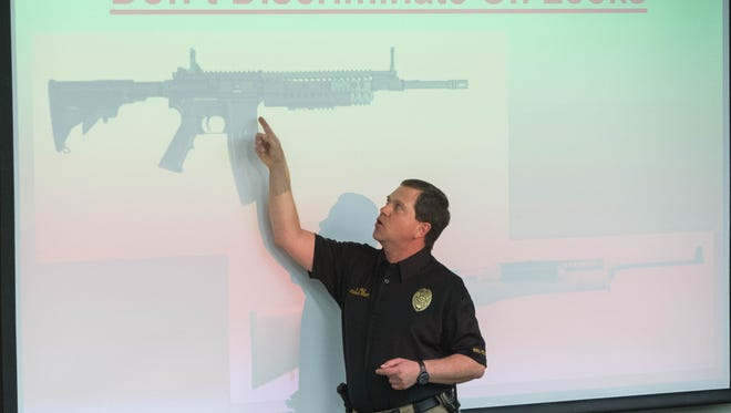 Stephen Lopez, New Mexico State University police chief, describes the difference between what is being called an assault rifle and non assault rife, during a forum on gun control at NMSU, Thursday, March 1, 2018.