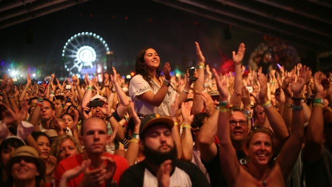 Fans applaud as OMD performs in the Gobi tent during the second weekend of the Coachella Valley Music and Arts Festival in Indio on Sunday, April 21, 2013.
