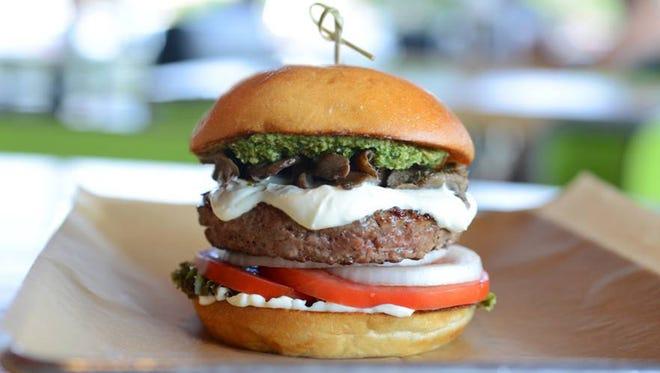 Hopdoddy's Magic Shroom burger has Angus beef, Texas goat cheese, field mushrooms, mayo and basil pesto.