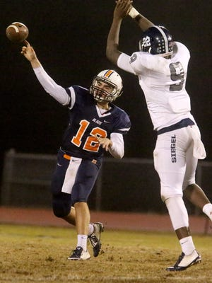 Blackman's quarterback Miller Armstrong (12) passes the ball as Siegel's Joseph Anderson (9) defends. Armstrong has thrown for more than 1,100 yards this season.