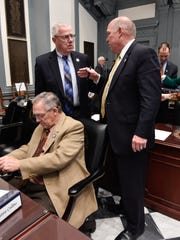 State Rep. Harvey Kenton, R-Milord, left talks with House Speaker Pete Schwartzkopf, D-Rehoboth Beach, at the Statehouse in Dover on Tuesday. Schwartzkopf was elected in 2002.