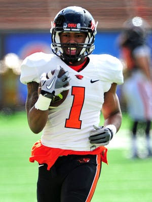 Oregon State running back Chris Brown carries the ball during practice inside Reser Stadium, on Saturday, April 4, 2015, in Corvallis.