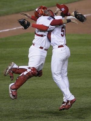St. Louis Cardinals' Adam Wainwright (50) celebrates with catcher Yadier Molina after defeating the Detroit Tigers in Game 5 of the World Series on Friday, Oct. 27, 2006 in St. Louis.